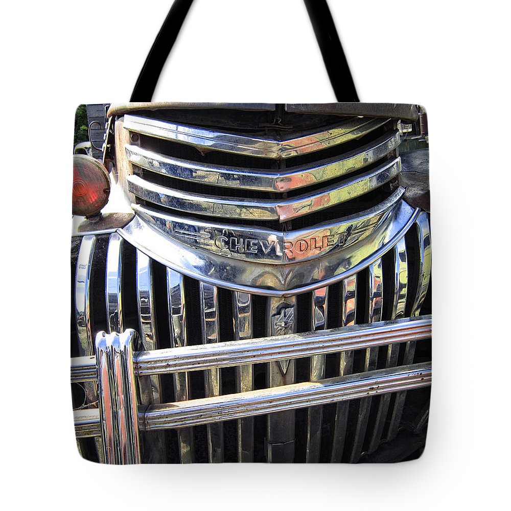 Chevy Tote Bag featuring the photograph 1946 Chevrolet Truck Chrome Grill by Daniel Hagerman