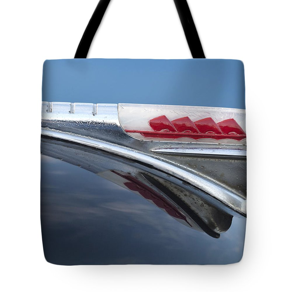 1947 Plymouth Tote Bag featuring the photograph 1947 Plymouth Hood Ornament by Jill Reger