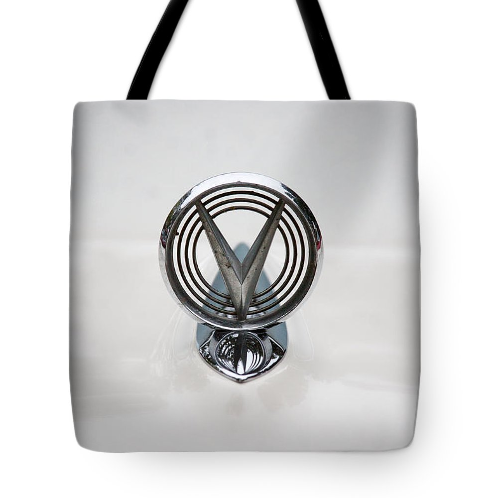 1955 Buick Special Photographs Tote Bag featuring the photograph 1955 Buick Special Hood Ornamant by Brooke Roby