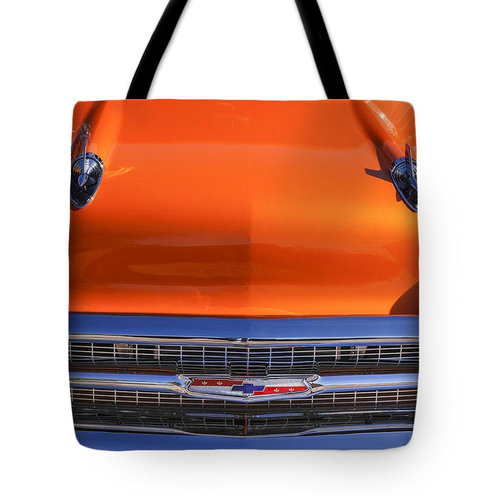 1957 Chevrolet Bel Air Hood Ornament Tote Bag featuring the photograph 1957 Chevrolet Belair Hood Ornament - Grille Emblem -055c by Jill Reger