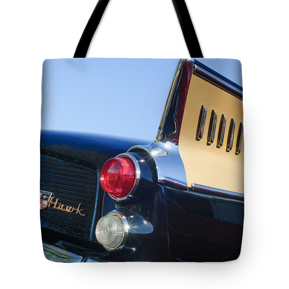 1957 Studebaker Golden Hawk Supercharged Sports Coupe Taillight Emblem Tote Bag featuring the photograph 1957 Studebaker Golden Hawk Supercharged Sports Coupe Taillight Emblem by Jill Reger