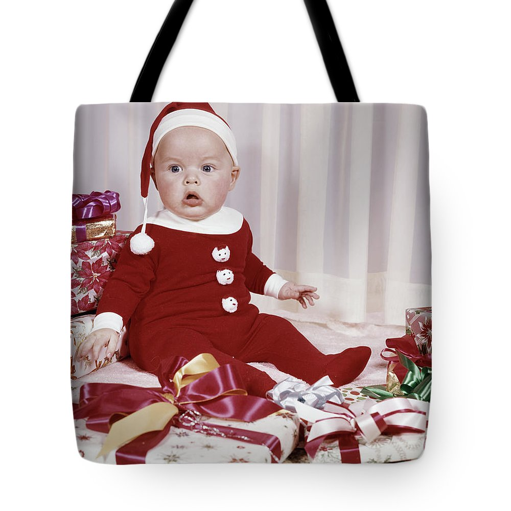 Photography Tote Bag featuring the photograph 1960s Amazed Baby In Santa Suit Sitting by Vintage Images