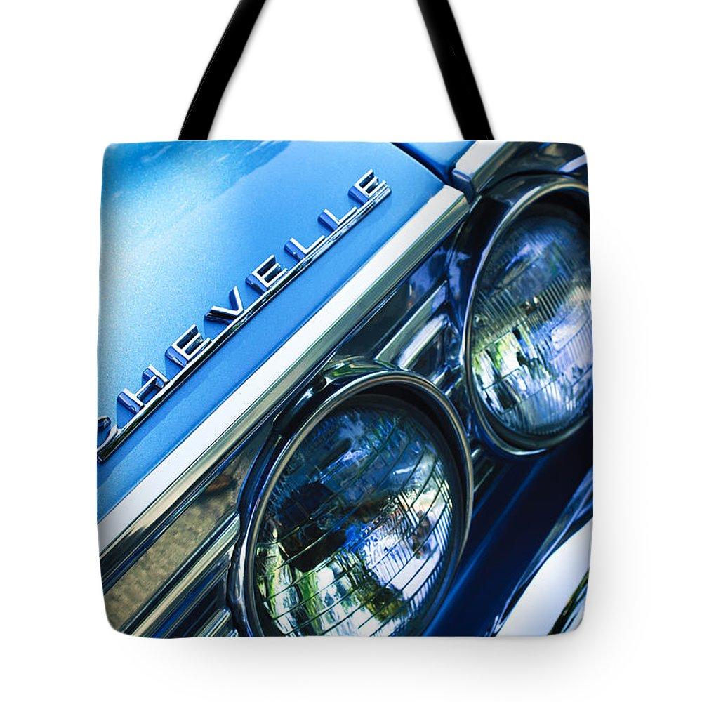 1967 Chevrolet Chevelle Malibu Head Light Emblem Tote Bag featuring the photograph 1967 Chevrolet Chevelle Malibu Head Light Emblem by Jill Reger