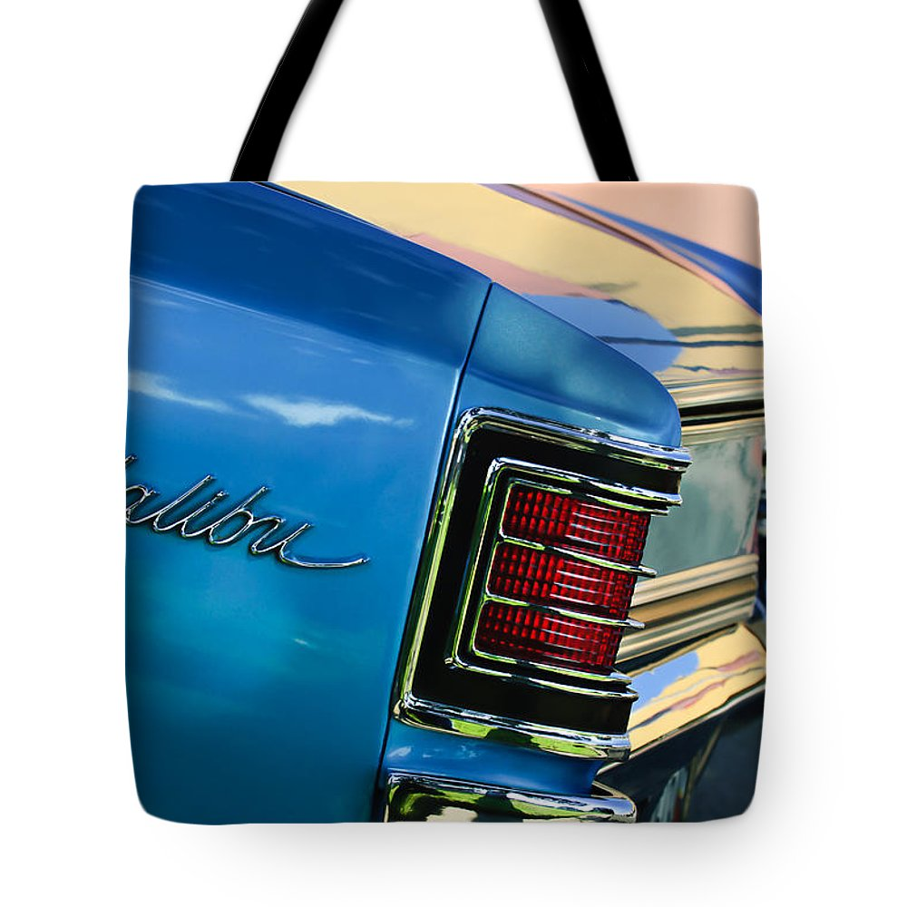 1967 Chevrolet Malibu Taillight Emblem Tote Bag featuring the photograph 1967 Chevrolet Malibu Taillight Emblem by Jill Reger
