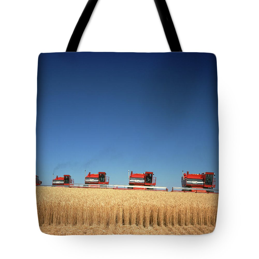 Photography Tote Bag featuring the photograph 1970s Five Massey Ferguson Combines by Vintage Images