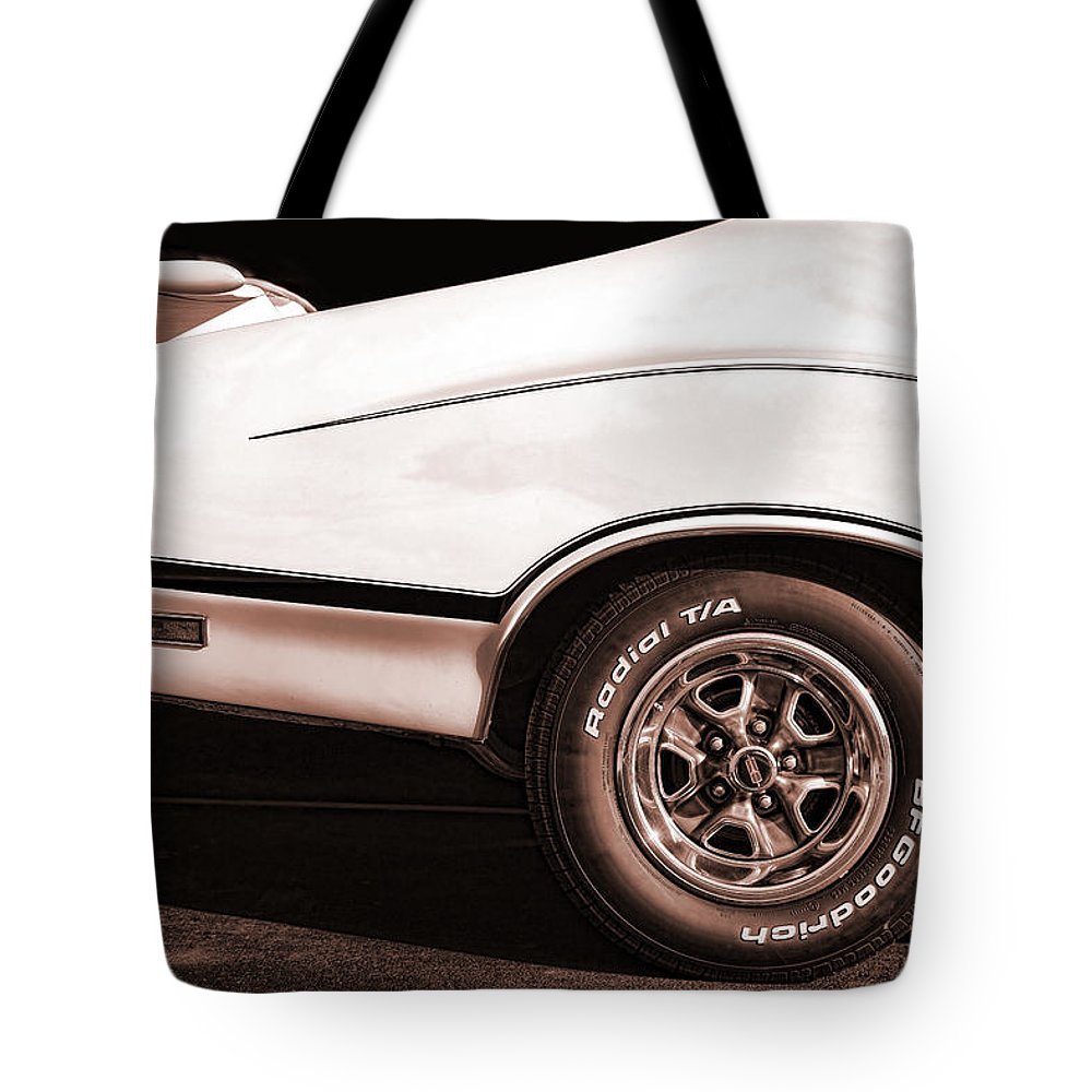 Oldsmobile Tote Bag featuring the photograph 1972 Oldsmobile Cutlass 4-4-2 by Gordon Dean II