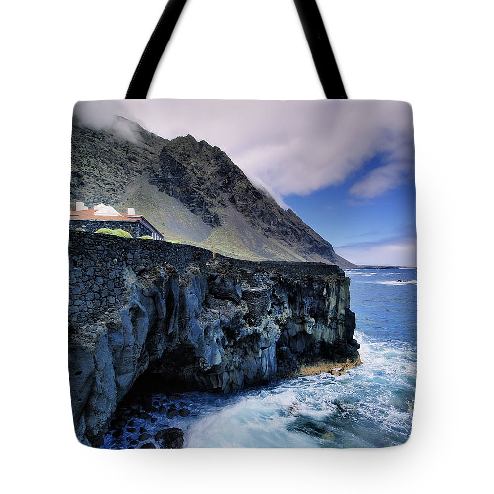 Cliff Tote Bag featuring the photograph Hierro by Karol Kozlowski