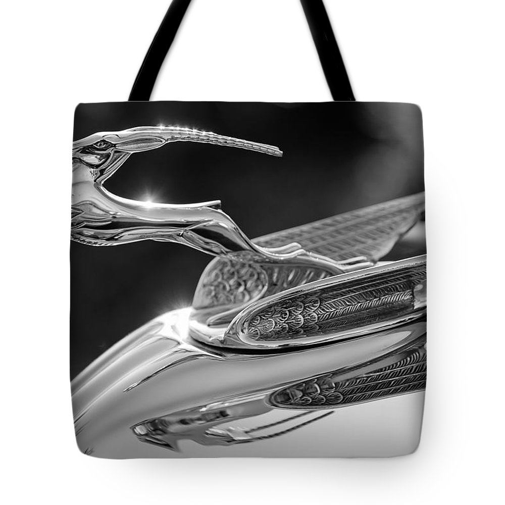 1933 Chrysler Imperial Tote Bag featuring the photograph 1933 Chrysler Imperial Hood Ornament -0484bw by Jill Reger