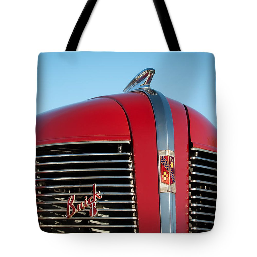 1937 Buick Boattail Roadster Grille Emblems Tote Bag featuring the photograph 1937 Buick Boattail Roadster Grille Emblems by Jill Reger