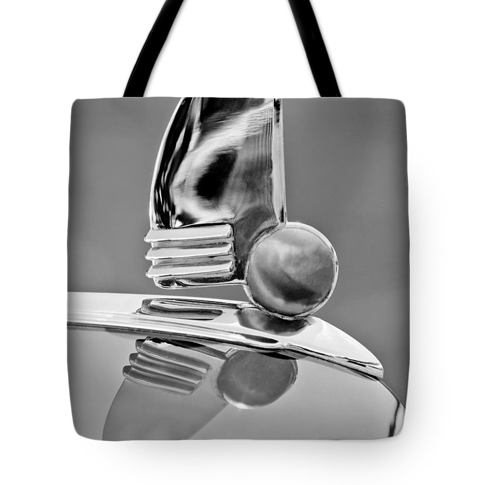 1942 Lincoln Continental Cabriolet Hood Ornament Tote Bag featuring the photograph 1942 Lincoln Continental Cabriolet Hood Ornament by Jill Reger