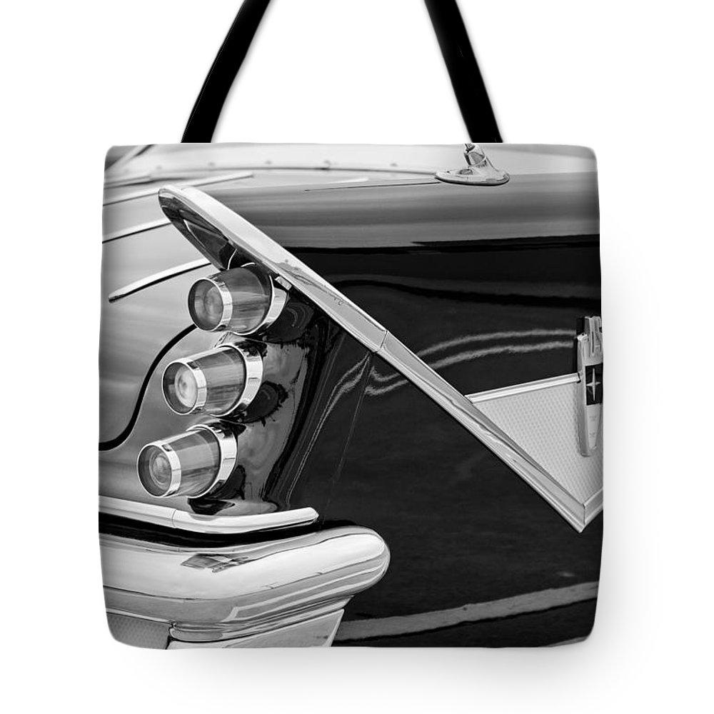 1959 Desoto Adventurer Convertible Tail Light Emblem Tote Bag featuring the photograph 1959 Desoto Adventurer Convertible Tail Light Emblem by Jill Reger