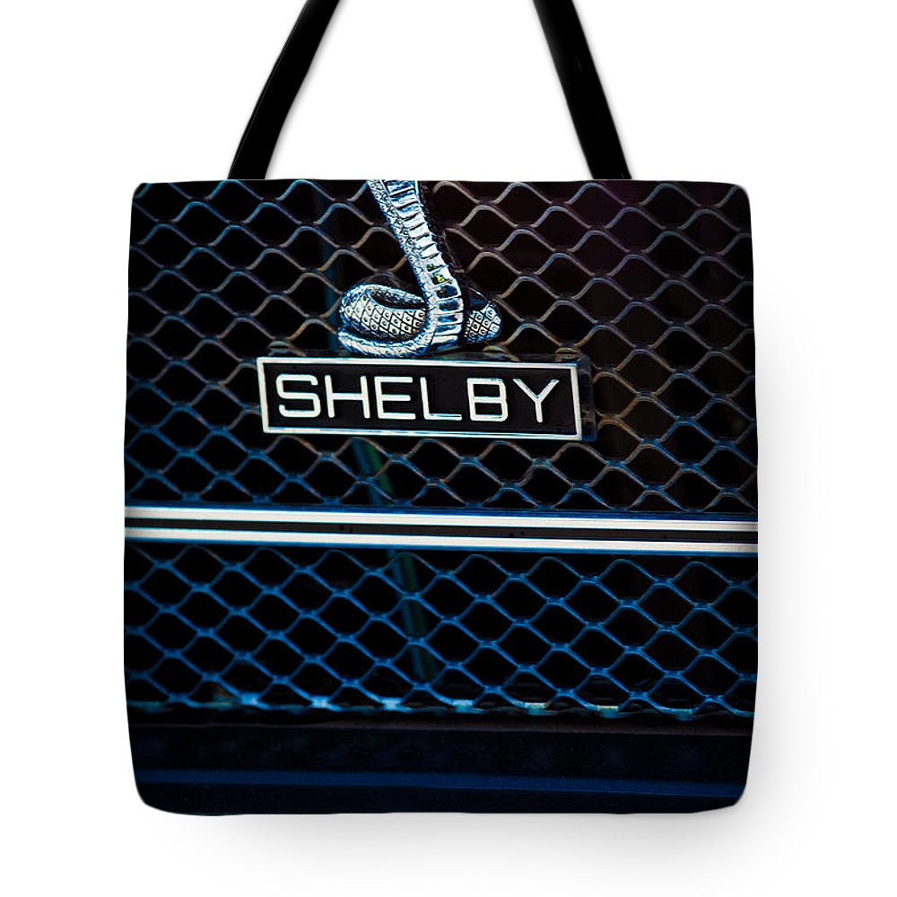 1969 Shelby Gt500 Convertible 428 Cobra Jet Grille Emblem Tote Bag featuring the photograph 1969 Shelby Gt500 Convertible 428 Cobra Jet Grille Emblem by Jill Reger