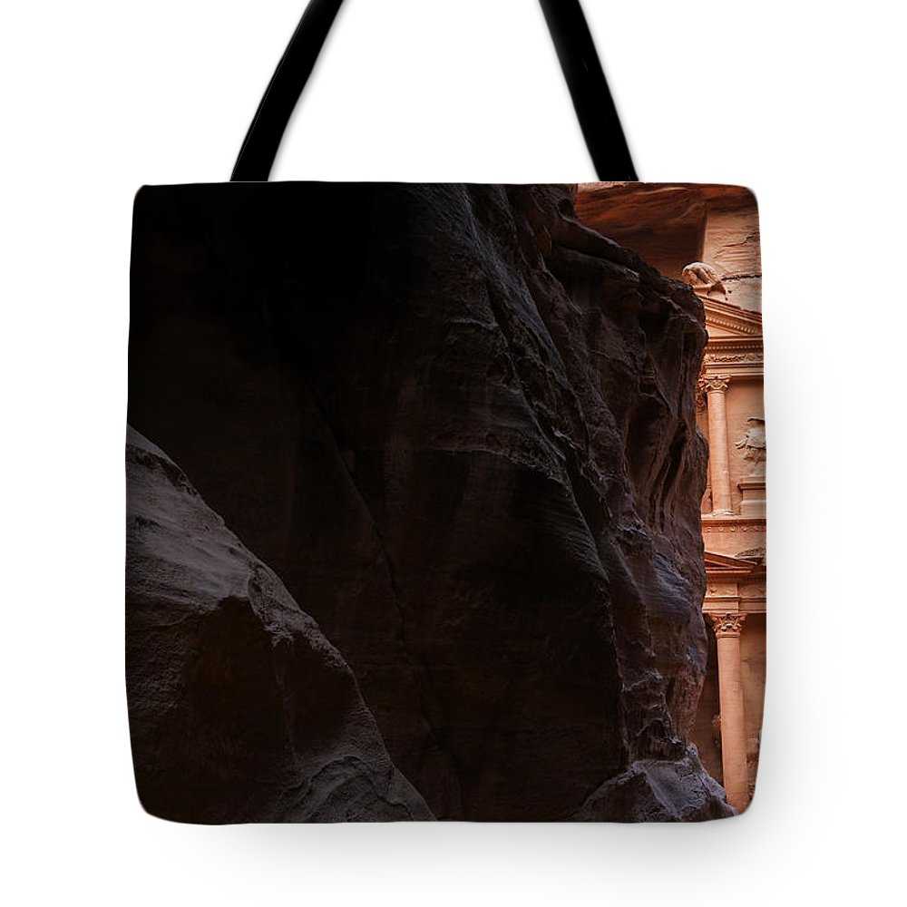 Petra Tote Bag featuring the photograph A Glimpse Of Al Khazneh From The Siq In Petra Jordan by Robert Preston