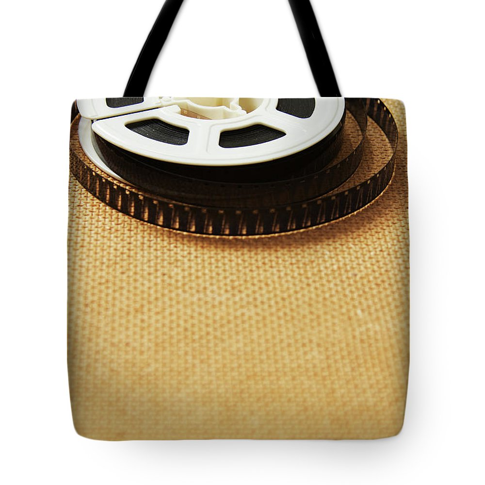 The Media Tote Bag featuring the photograph A Reel, Or Spool, Of 8mm Movie Film by Jon Schulte