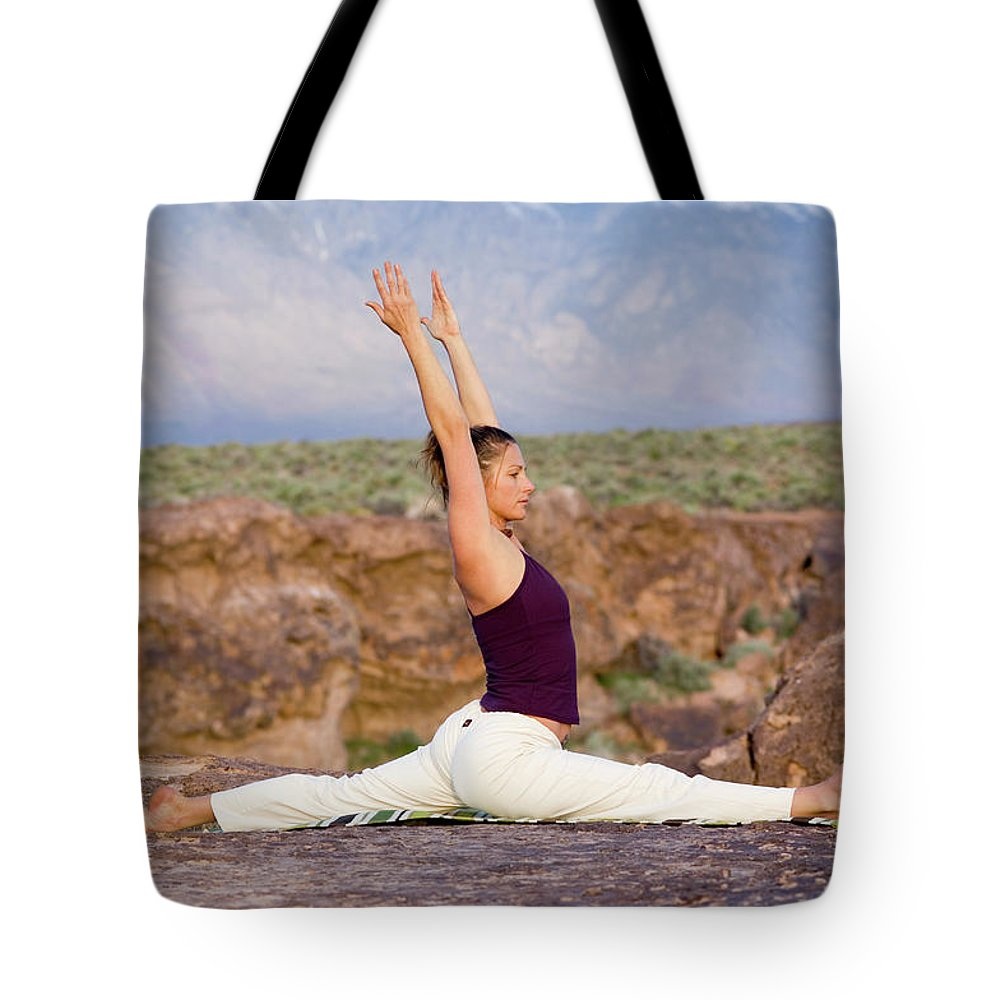 Bishop Tote Bag featuring the photograph A Woman Practicing Yoga On A Dry Lake by Lars Schneider
