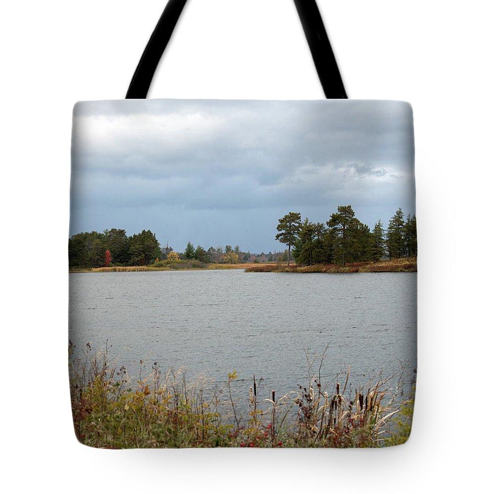 Upper Peninsula Tote Bag featuring the photograph Across The Water by Linda Kerkau