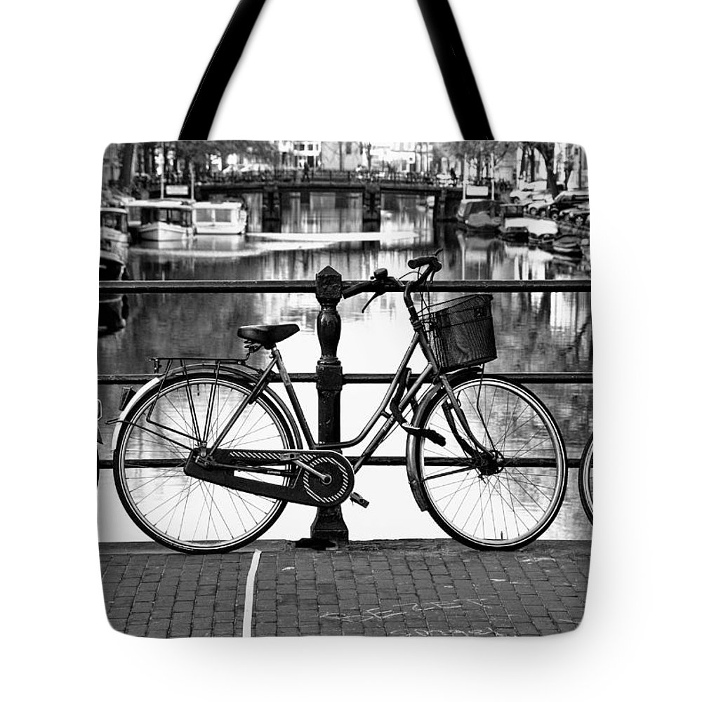 Black And White Photograph Tote Bag featuring the photograph Amsterdam Scene by Allen Beatty