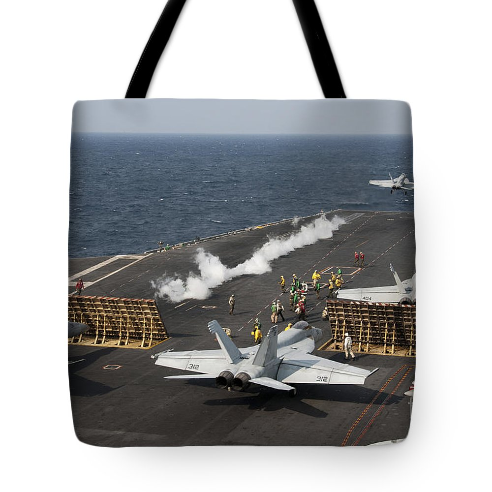 Military Tote Bag featuring the photograph An Fa-18 Hornet Launches by Stocktrek Images