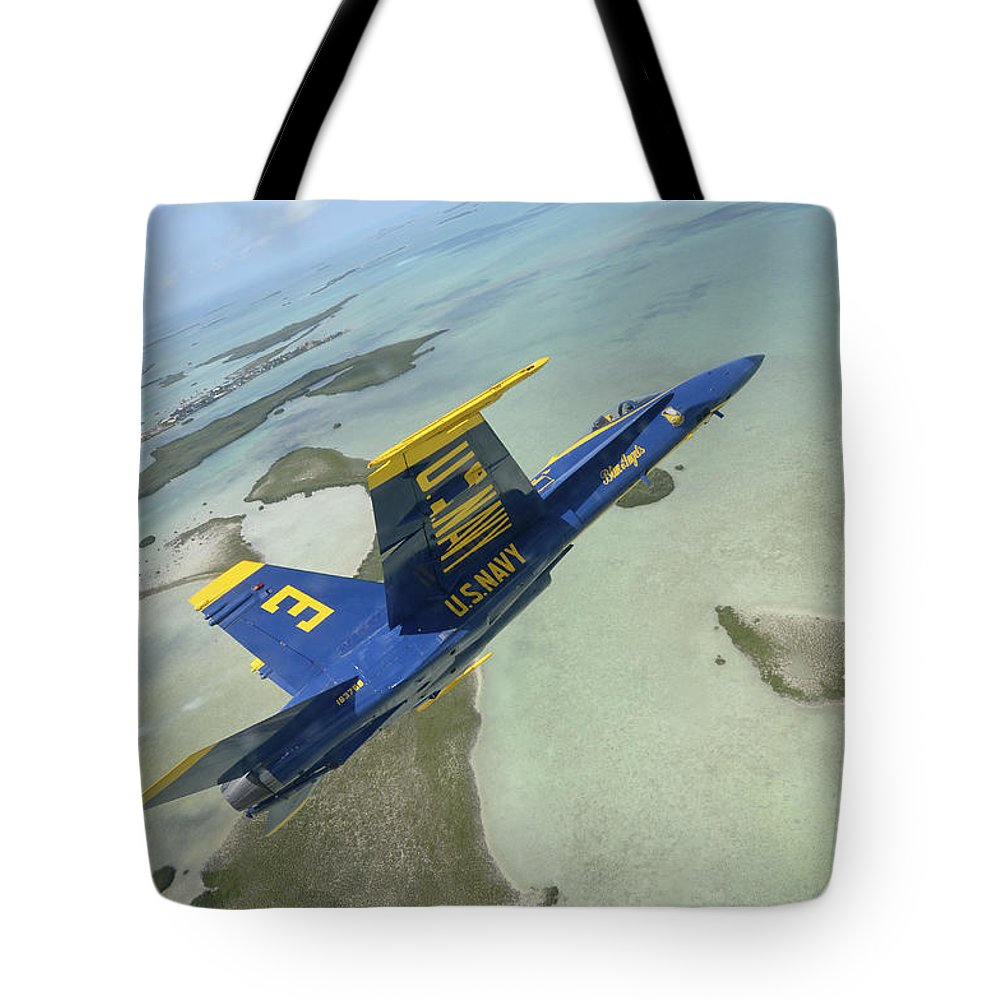 Key West Tote Bag featuring the photograph An Fa-18 Hornet Of The Blue Angels by Stocktrek Images