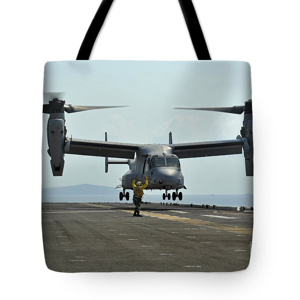 Military Tote Bag featuring the photograph Aviation Boatswains Mate Signals An by Stocktrek Images