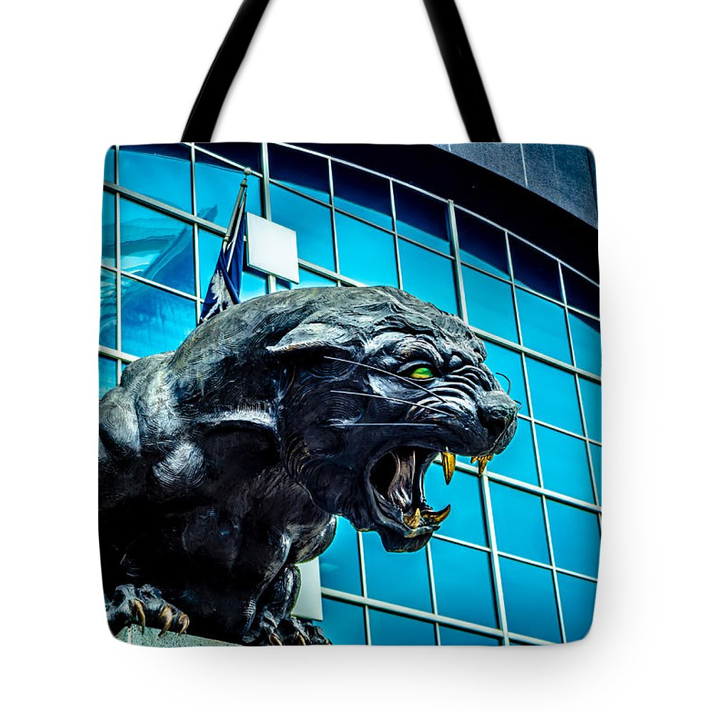 Action Tote Bag featuring the photograph Black Panther Statue by Alex Grichenko