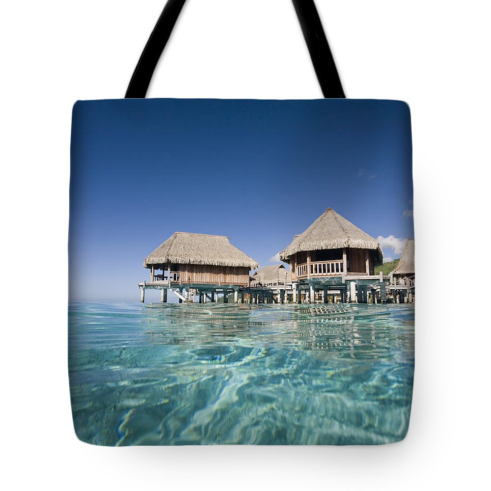 Above Tote Bag featuring the photograph Bungalows Over Ocean by M Swiet Productions