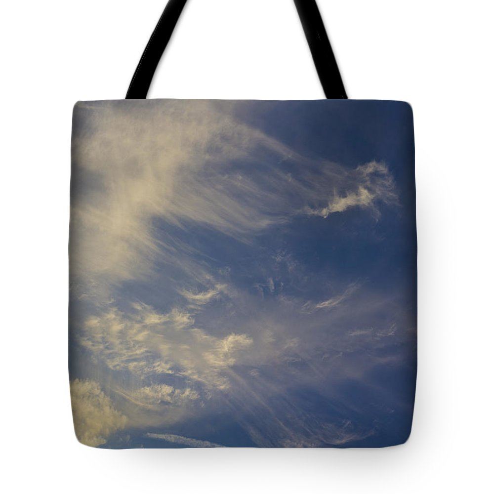 Swirling Clouds Tote Bag featuring the photograph Evening Sky by David Pyatt