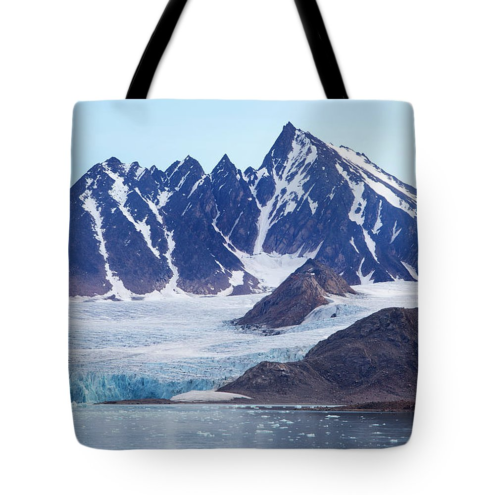 Scenics Tote Bag featuring the photograph Glaciers Tumble Into The Sea In The by Anna Henly