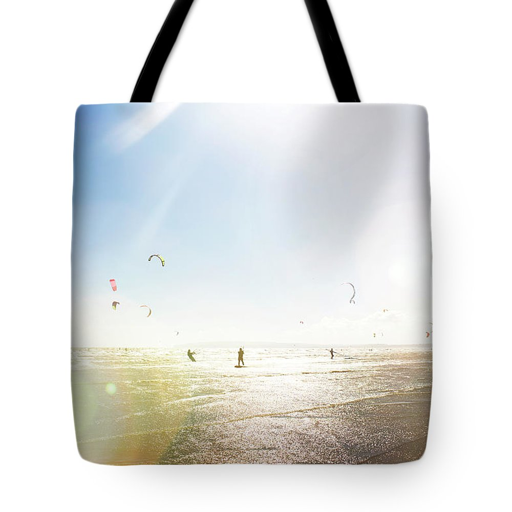Water's Edge Tote Bag featuring the photograph Kite Surfers by Nick David