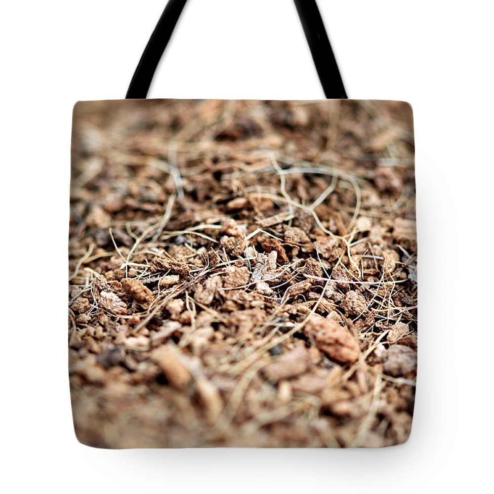 Mulch Tote Bag featuring the photograph Mulch by Henrik Lehnerer