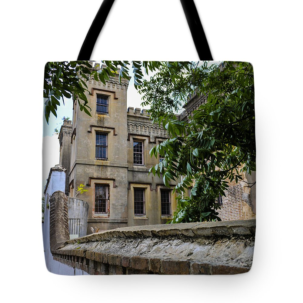 Jail Tote Bag featuring the photograph Peek Through The Tree's Of Old City Jail by Dale Powell
