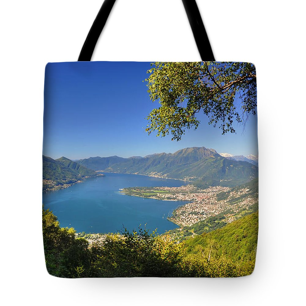 Panoramic View Tote Bag featuring the photograph Panoramic View Over An Alpine Lake by Mats Silvan