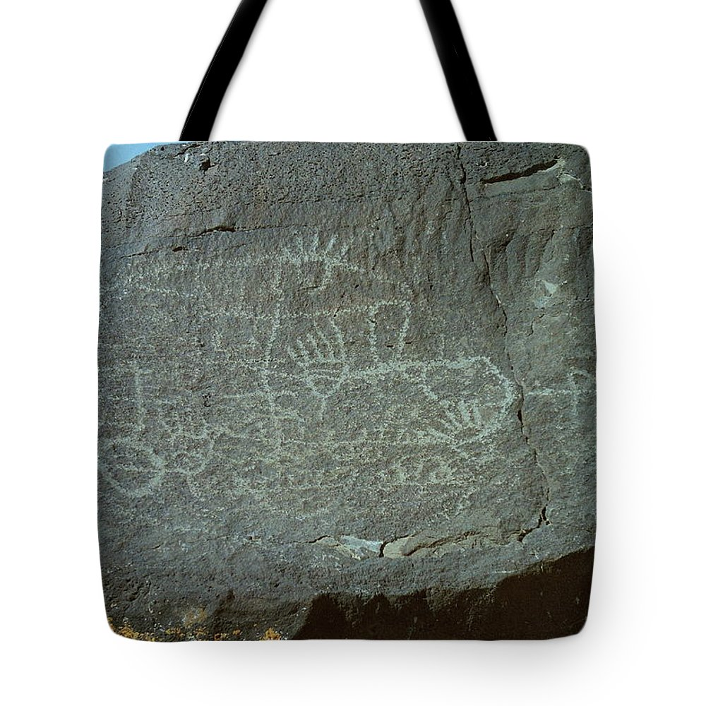 Petroglyph Rock Tote Bag featuring the photograph Petroglyph Rock by Mike Wheeler