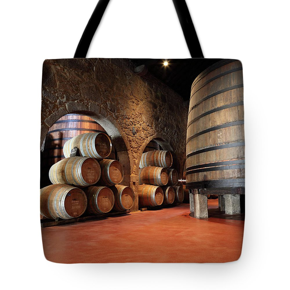 Fermenting Tote Bag featuring the photograph Porto Wine Cellar by Vuk8691