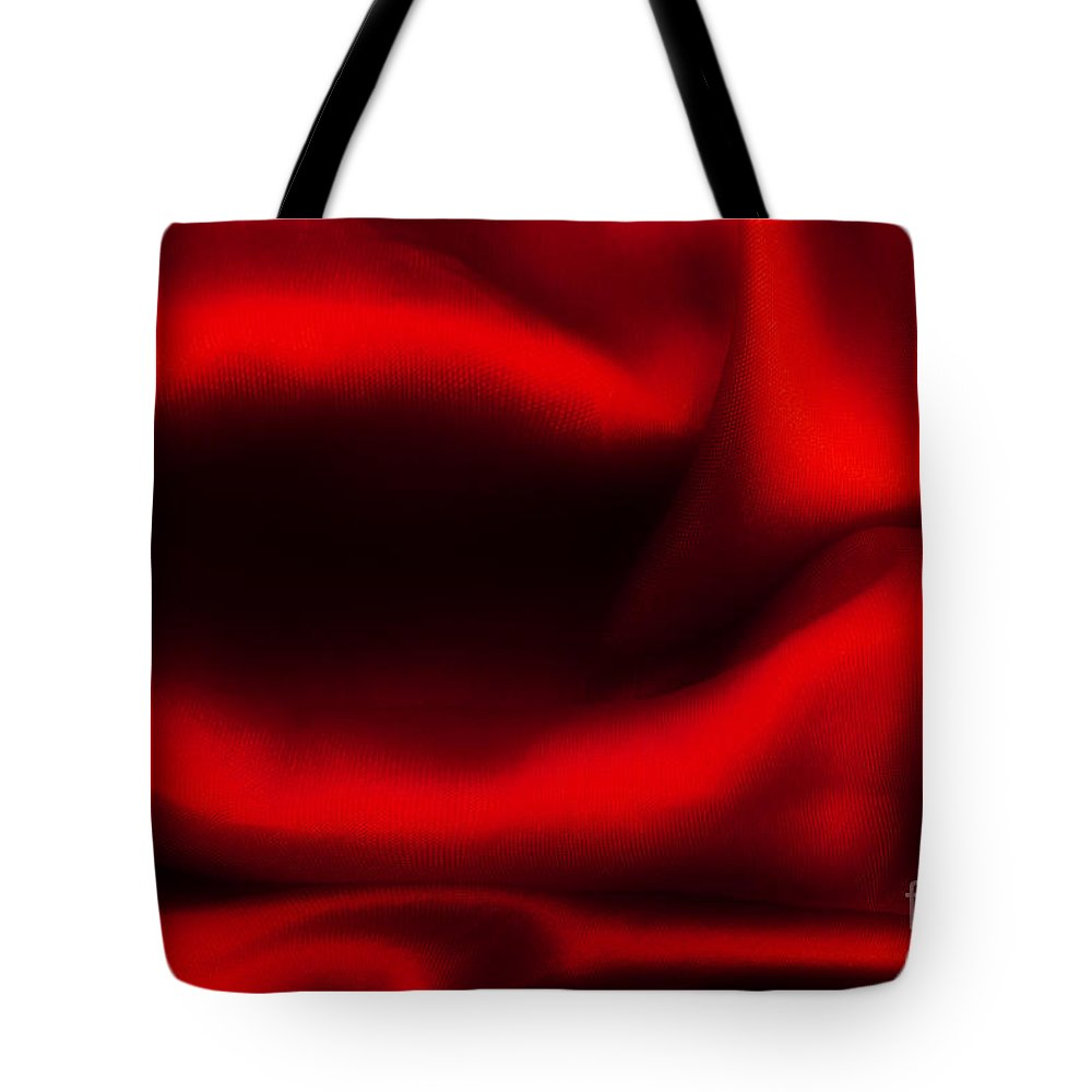 Satin Tote Bag featuring the photograph Red Folded Satin Background by Michal Bednarek