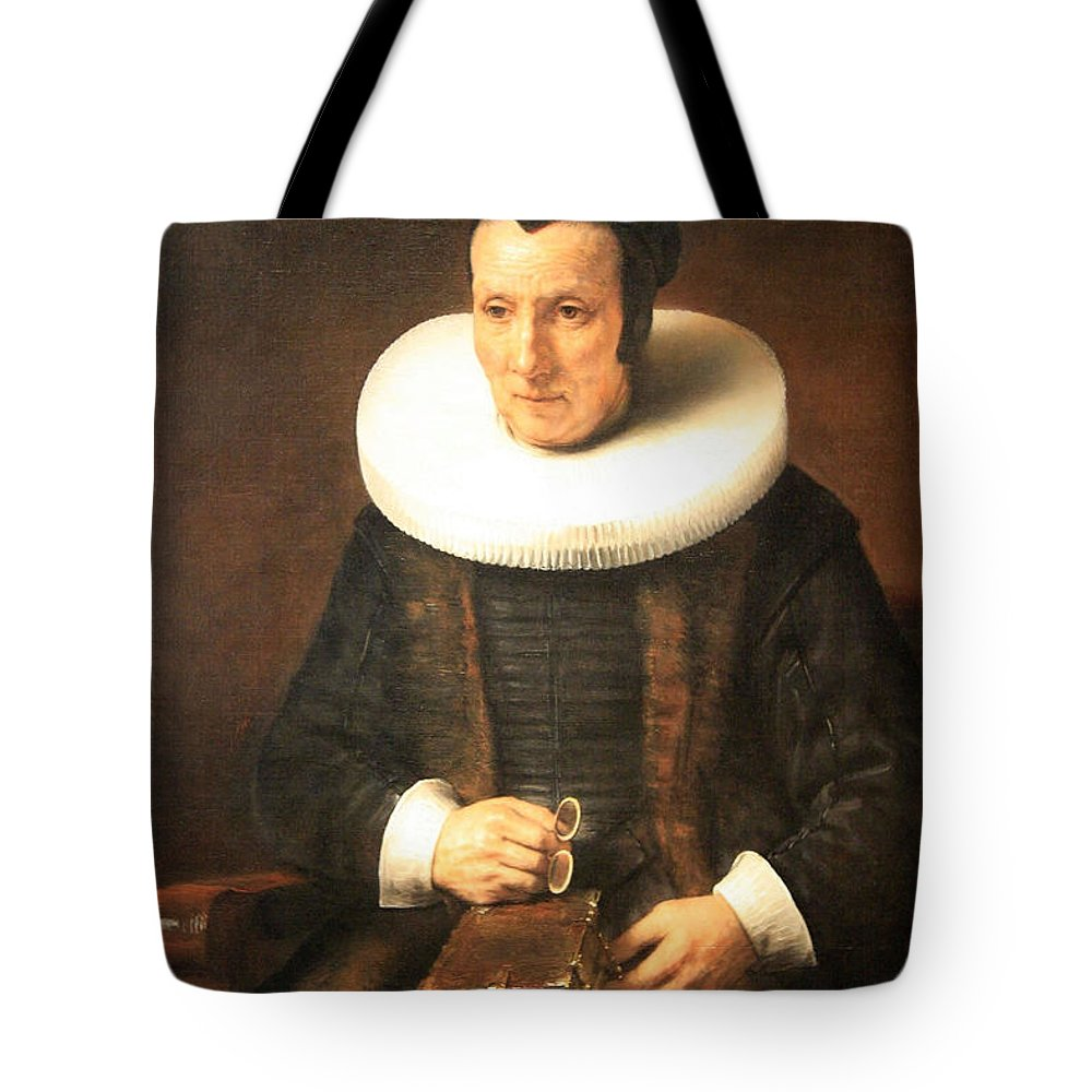 An Tote Bag featuring the photograph Rembrandt's An Old Lady With A Book by Cora Wandel