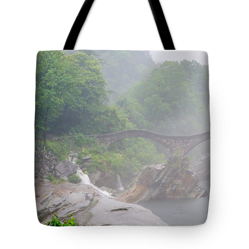 Roman Bridge Tote Bag featuring the photograph Roman Bridge by Mats Silvan
