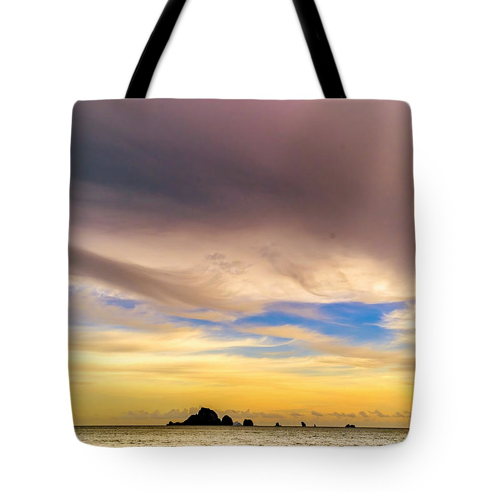 Sky Tote Bag featuring the photograph Sunset by Jijo George
