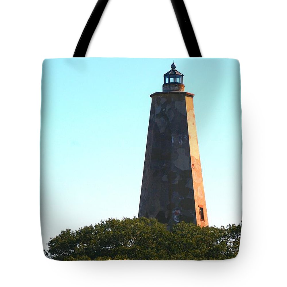 Lighthouse Tote Bag featuring the photograph The Lighthouse by Nadine Rippelmeyer