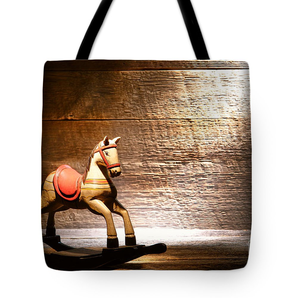 Rocking Horse Tote Bag featuring the photograph The Old Rocking Horse In The Attic by Olivier Le Queinec
