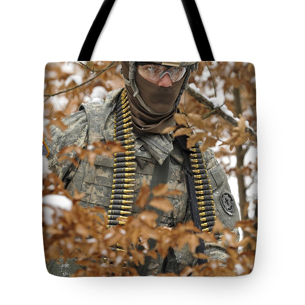Military Tote Bag featuring the photograph U.s. Army Soldier Conducts A Dismounted by Stocktrek Images