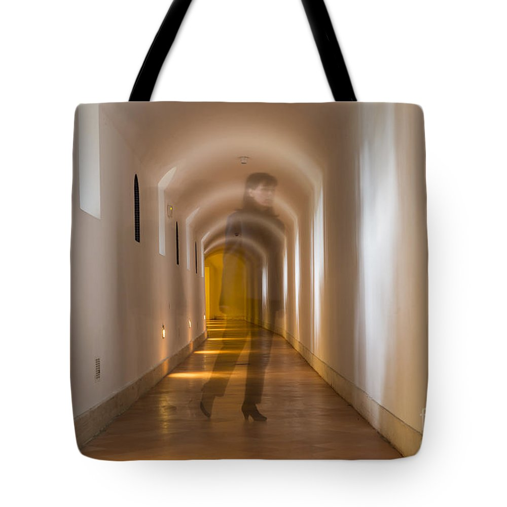 Corridor Tote Bag featuring the photograph Walking In A Tunnel by Mats Silvan