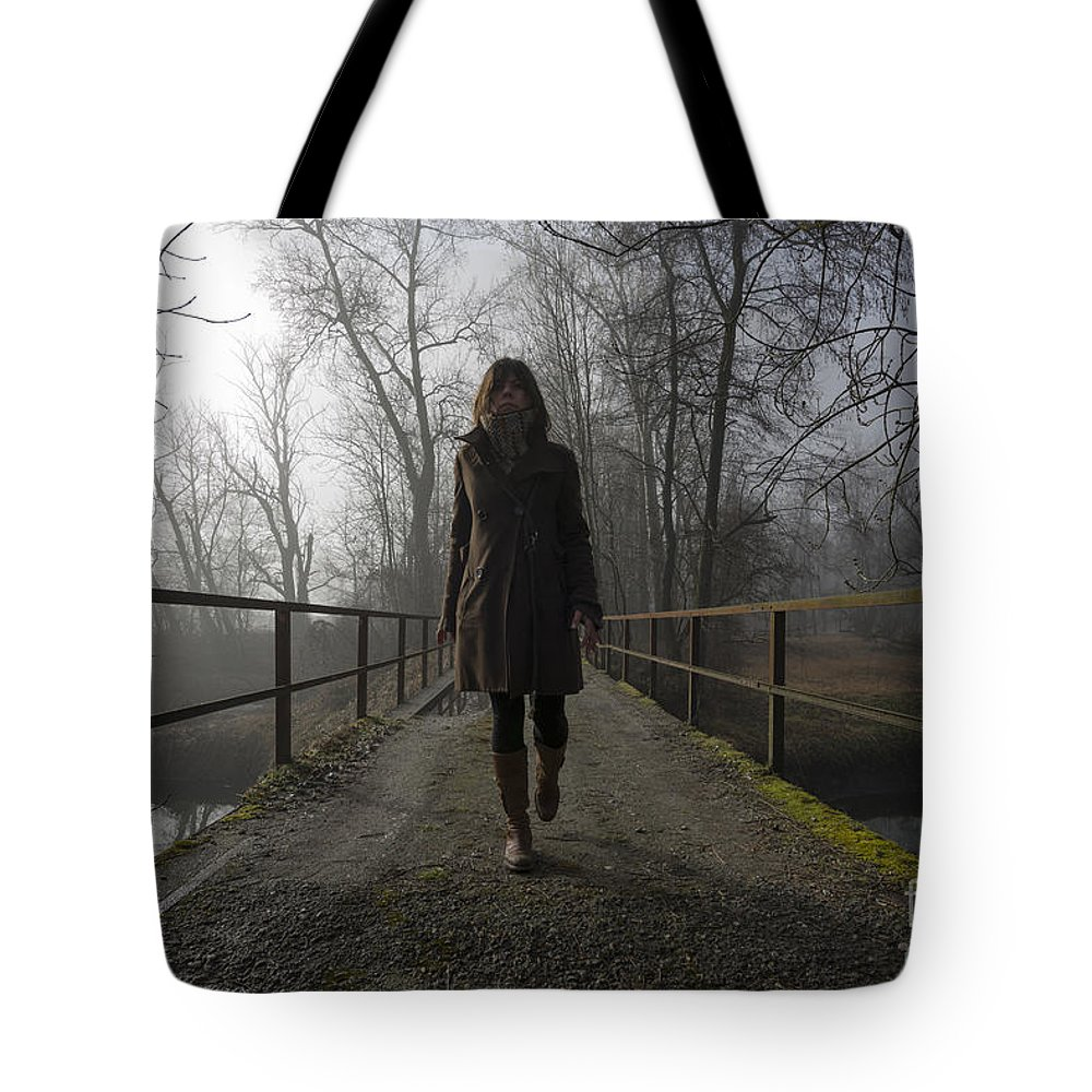 Bridge Tote Bag featuring the photograph Woman Walking On A Bridge by Mats Silvan