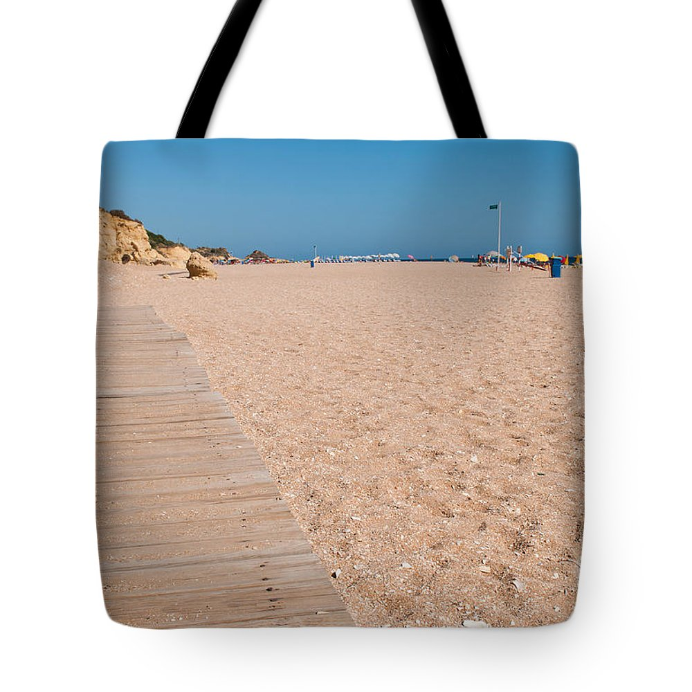Beach Tote Bag featuring the photograph Wooden Walkway On Beach by Luis Alvarenga