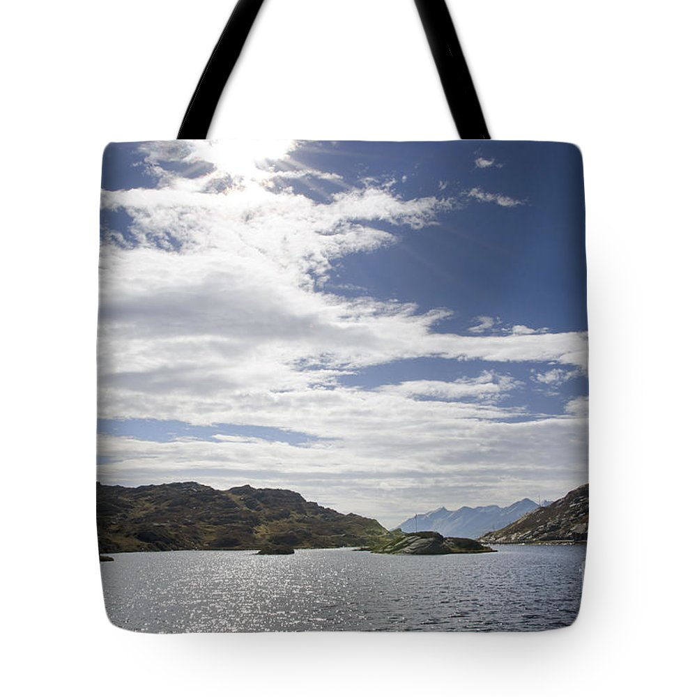 Panoramic View Tote Bag featuring the photograph Alpine Lake by Mats Silvan
