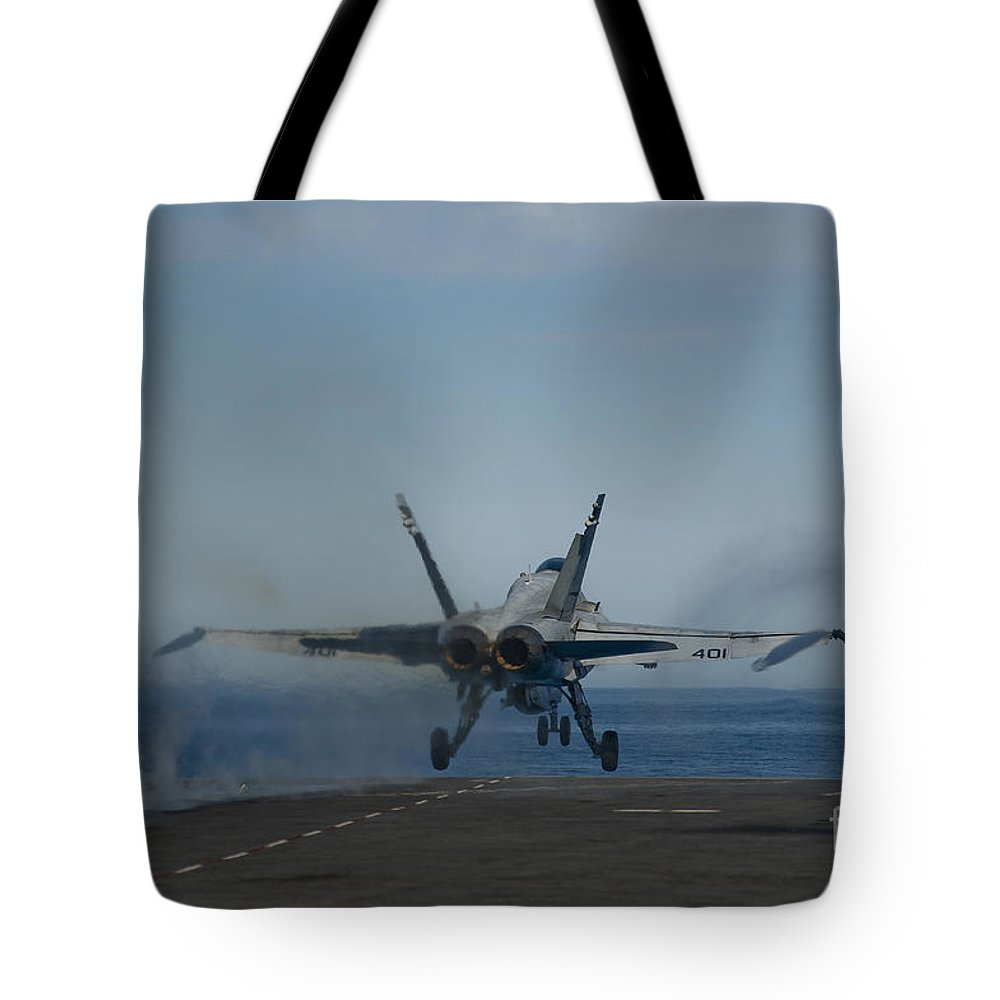 Military Tote Bag featuring the photograph An Fa-18c Hornet Launches by Stocktrek Images