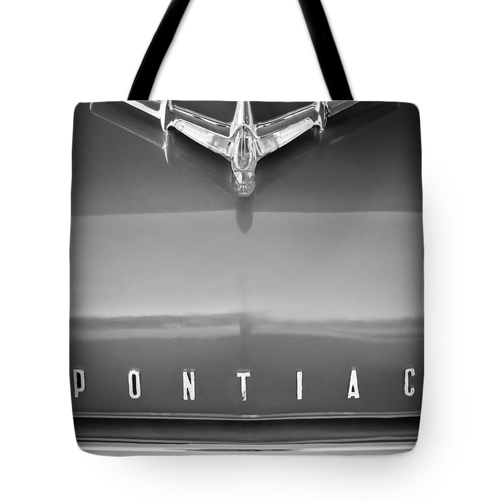 1955 Pontiac Safari Hood Ornament Tote Bag featuring the photograph 1955 Pontiac Safari Hood Ornament by Jill Reger