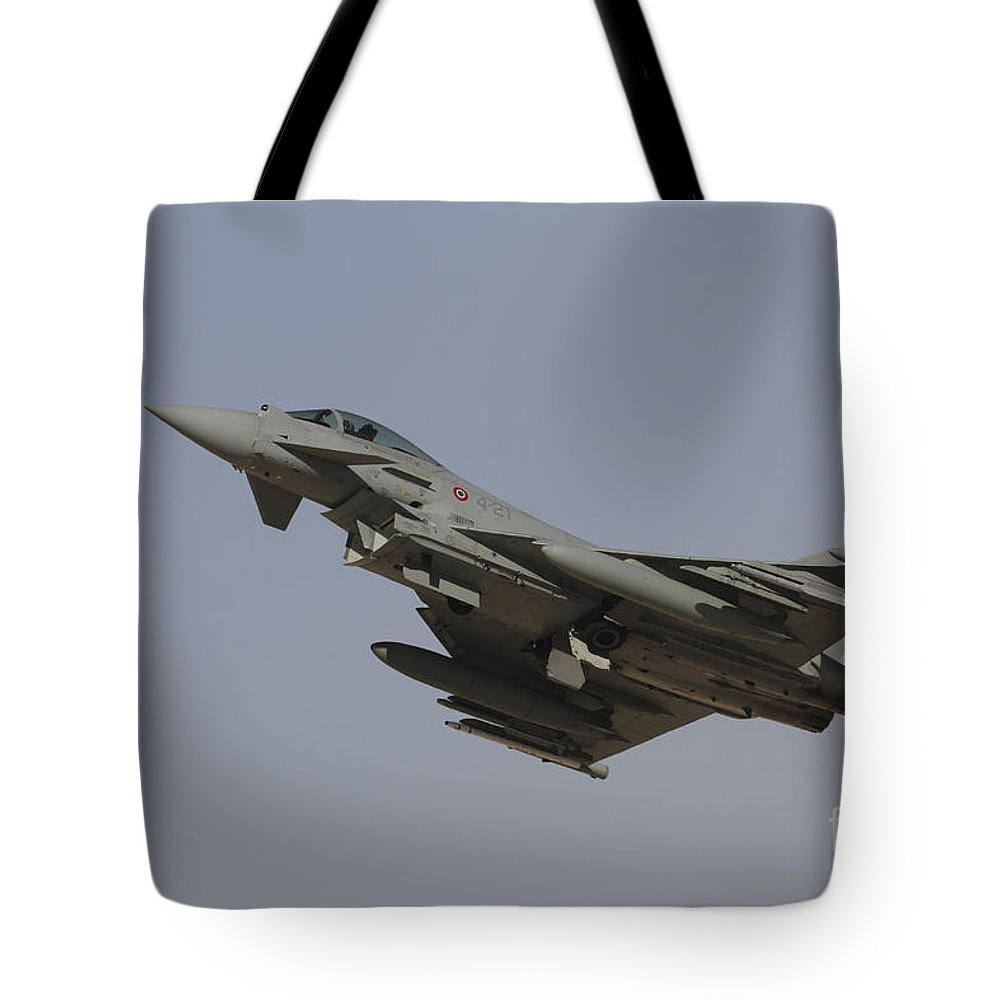 Military Tote Bag featuring the photograph A Eurofighter Typhoon Of The Italian by Ofer Zidon