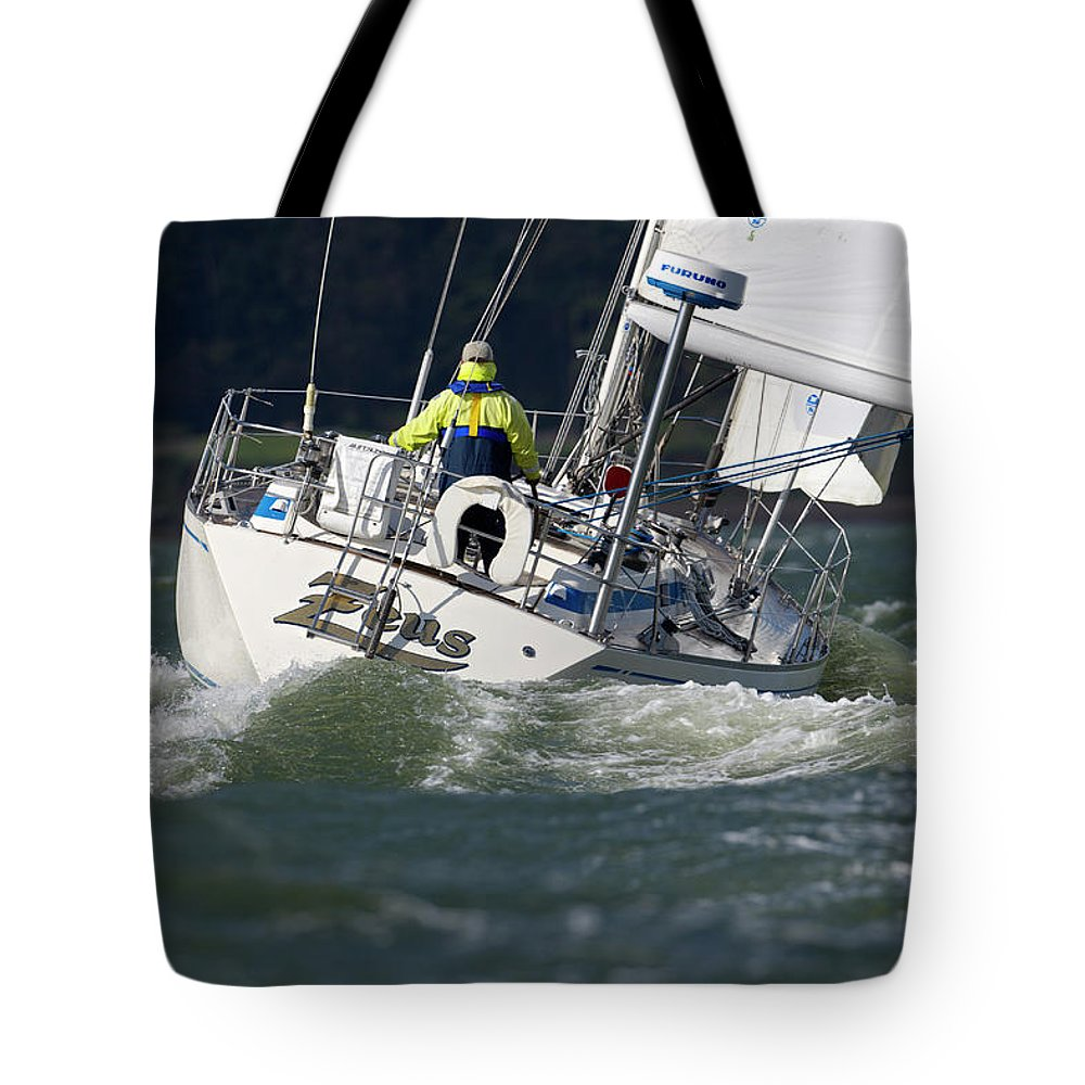 50s Tote Bag featuring the photograph A Sailor Singlehands His 39 Foot by Abner Kingman