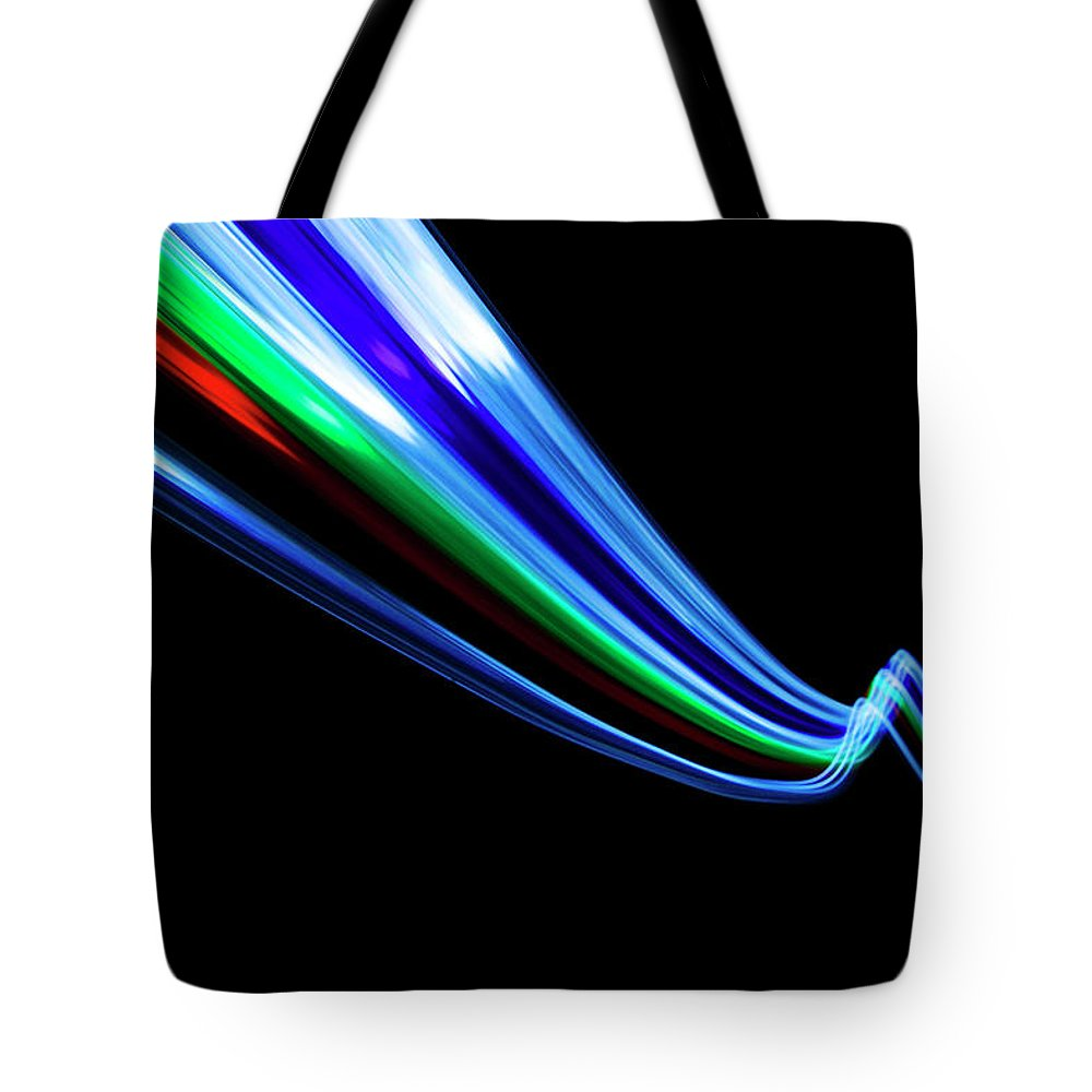 Black Background Tote Bag featuring the photograph Abstract Light Trails And Streams by John Rensten